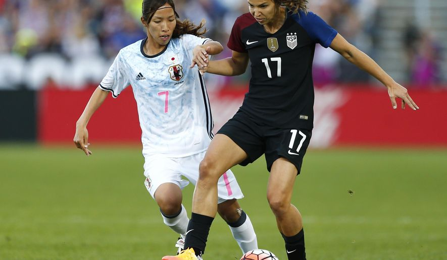 U.S. midfielder Tobin Heath (17) and Japan midfielder Emi Nakajima (7) chase the ball during the first half of an International friendly soccer match Thursday, June 2, 2016, in Commerce City, Colo. (AP Photo/Jack Dempsey)