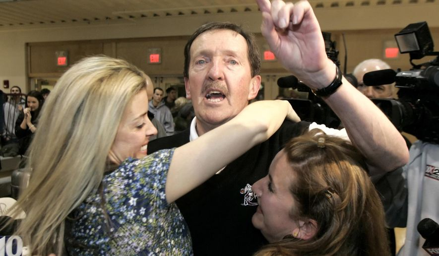 FILE - In this Feb. 1, 2007, file photo, Philadelphia head men's basketball coach Herb Magee, center, celebrates his 829th career coaching victory, a new NCAA Division II record, with his daughters Kay, left, and Eileen, after his team defeated Wilmington College, 65-60, in overtime in Philadelphia. Magee, who has won more than 1,000 games at Philadelphia University, and Marianne Stanley, who led Old Dominion women's teams to three national championships, have won the Lapchick Character Award. They will be honored Nov. 18 at a luncheon in New York. (AP Photo/Tom Mihalek, File)