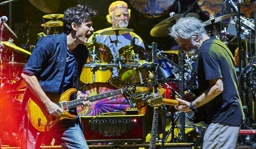 FILE - In this Oct. 31, 2015 file photo, from left, John Mayer, Bill Kreutzmann  and Bob Weir of Dead & Company perform at Madison Square Garden in New York. The group says it will perform a concert in Charlotte, N.C., on June 10, but will also donate $100,000 to organizations that fight against discrimination. (Photo by Robert Altman /Invision/AP, File)