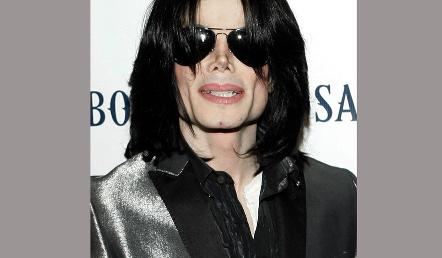 FILE - In this Nov. 8, 2007 file photo, pop star Michael Jackson poses on the red carpet during the RainbowPUSH Coalition Los Angeles 10th annual awards in Los Angeles. The Las Vegas mansion where pop icon Jackson reportedly lived is up for sale for $9.5 million. (AP Photo/Danny Moloshok, File)