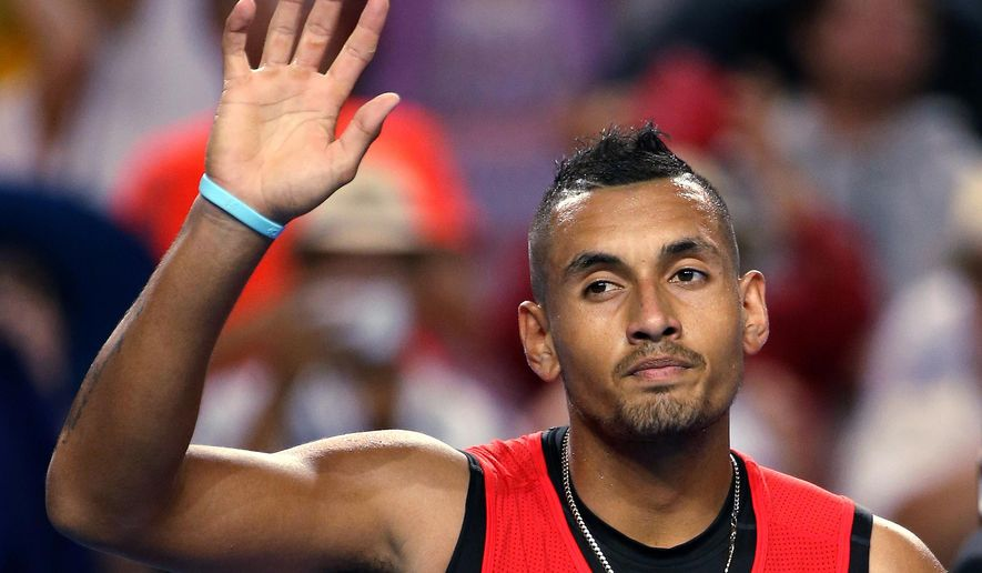 """FILE - In this Jan. 18, 2016, file photo, Nick Kyrgios of Australia waves after defeating Carreno Busta of Spain during their first round match at the Australian Open tennis championships in Melbourne, Australia. Kyrgios has withdrawn his name from consideration for Australia's tennis team for the Olympics in Rio de Janeiro, citing """"unfair and unjust treatment"""" by national Olympic officials. (AP Photo/Rick Rycroft, File)"""