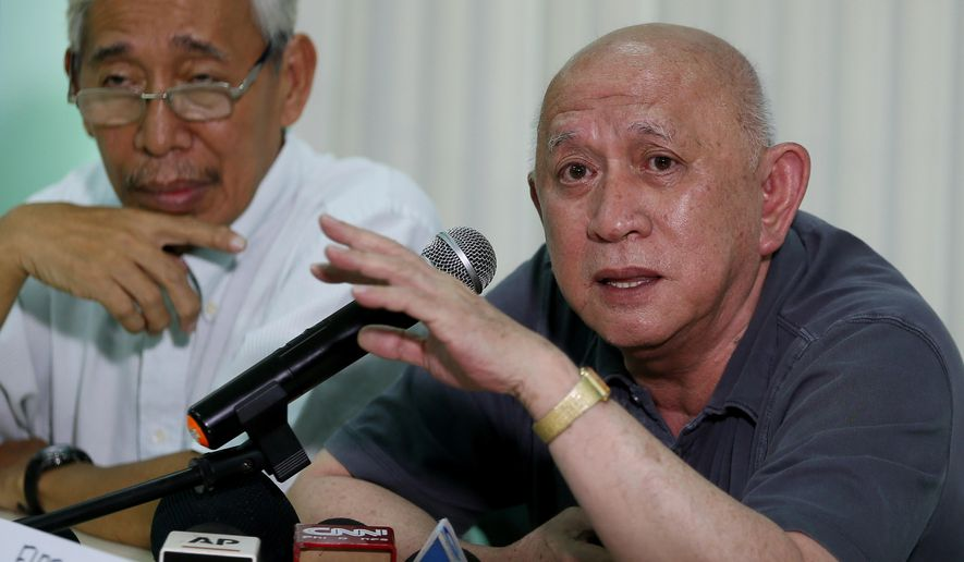 "Communist rebel negotiator Fidel Agcaoili, right, gestures during a rare news conference, Thursday, June 2, 2016 in Quezon city, northeast of Manila, Philippines. Agcaoili said communist guerrillas demand an end to US military presence in the Philippines as the insurgents and the government of incoming President Rodrigo Duterte brace to resume long-stalled peace talks. Agcaoili said the guerrilla demand ""is non-negotiable,"" adding that government and rebel negotiators were preparing to meet in Europe soon and discuss the resumption of peace negotiations, which could start as early as July. At left is negotiator Randall Echanis. (AP Photo/Bullit Marquez)"