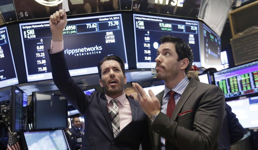 "FILE - In this Oct. 14, 2014, file photo, Jonathan Scott, left, and Drew Scott, of HGTV's ""Property Brothers"" cable television show, mimic traders as they visit the post that handles Scripps Networks Interactive, on the floor of the New York Stock Exchange in New York. Authorities in North Dakota declined to file charges against Jonathan Scott over an April 24, 2016, incident at a Fargo bar.  (AP Photo/Richard Drew, File)"