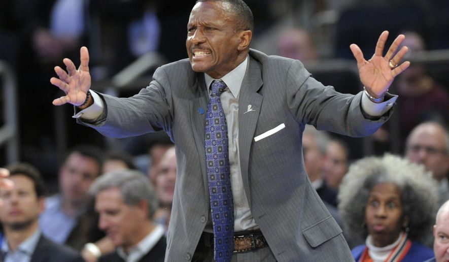 FILE - In this Feb. 22, 2016, file photo, Toronto Raptors coach Dwane Casey reacts during the third quarter of an NBA basketball game against the New York Knicks, at Madison Square Garden in New York.  A person with knowledge of the situation tells The Associated Press that the Toronto Raptors have agreed to terms with coach Dwane Casey on a three-year, $18 million contract extension. The two sides reached an agreement on Thursday, June 2, 2016. The person spoke on condition of anonymity because the team has not announced the deal. (AP Photo/Bill Kostroun, File)