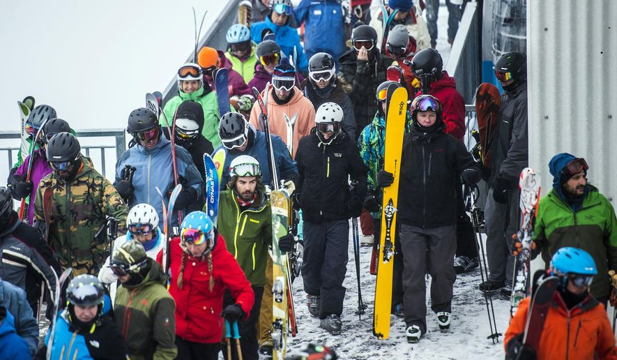 This photo taken Dec. 30, 2016, shows skiers and snowboarders offloading at the tram at Hidden Peak at Snowbird Ski and Summer Resort in Snowbird, Utah. Utah ski resorts recorded a 10-year high for visitors this past season, likely fueled by good early-winter snow and buzz created by Vail Resort's merging of two ski areas into one mega resort. The nearly 4.5 million skier visits in the 2015-16 season surpassed the previous high of 4.2 million in 2007-08, Ski Utah President Nathan Rafferty said Thursday, June 2, 2016, at a news conference. The total also marked a 13 percent increase from the previous season, which was the second-lowest in the last decade.  (Chris Detrick/The Salt Lake Tribune via AP)