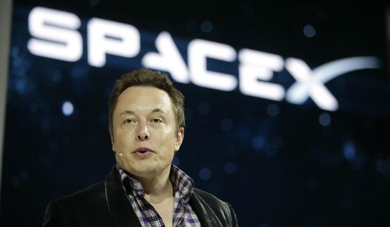 In this May 29, 2014, file photo, Elon Musk, CEO and CTO of SpaceX, introduces the SpaceX Dragon V2 spaceship at the SpaceX headquarters in Hawthorne, Calif. Musk predicted during an interview at the Code Conference in southern California on June 1, 2016, that people would be on Mars in 2025. (AP Photo/Jae C. Hong, File)