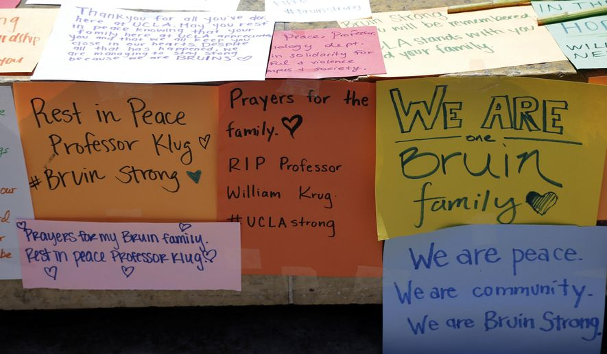 Condolence notes for the engineering professor who was shot and killed on Wednesday, are left at the foot of UCLA's Bruin Bear statue on Thursday, June 2, 2016. Students wrapped up classwork and prepared for finals as the UCLA campus tried to regain a sense of normalcy a day after being rocked by a murder-suicide that prompted a lockdown and an enormous police response. (AP Photo/Nick Ut)