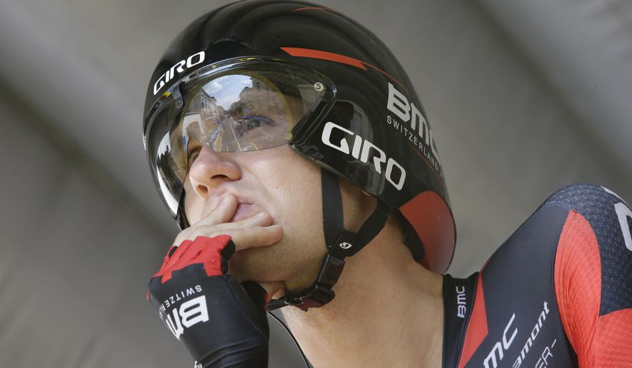 FILE - In this July 26, 2014, file photo, Tejay van Garderen of the U.S. concentrates prior to the start of the 20th stage of the Tour de France cycling race in Bergerac, France. American cyclist Tejay van Garderen has withdrawn his name from consideration for the Rio Olympics amid concerns that he may contract the Zika virus and pass it along to his pregnant wife. (AP Photo/Laurent Cipriani, File)