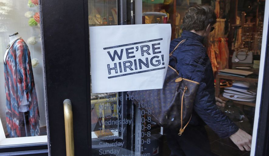 "In this Wednesday, May 18, 2016, file photo, a woman passes a ""We're Hiring!"" sign while entering a clothing store in the Downtown Crossing of Boston. On Friday, June 3, 2016, the U.S. government issues the May jobs report. (AP Photo/Charles Krupa, File)"