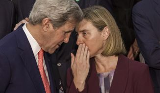 European Union High Representative for Foreign Affairs, Federica Mogherini (right) chats with U.S. Secretary of State John Kerry while posing for a group photo at the opening of an international meeting in a bid to revive the Israeli-Palestinian peace process in Paris on June 3, 2016. U.S., European and Arab diplomats meet in Paris for a French-led effort to revive the Mideast peace process, despite skepticism from Israel. (Associated Press)