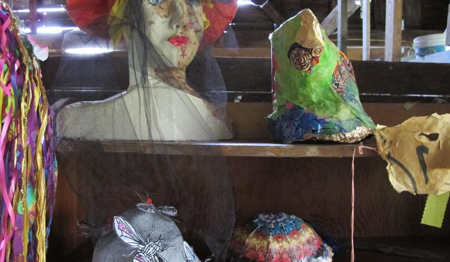 A collection of bug-related hats, some with insect netting, in advance of the annual Blackfly festival, giving tribute to the spring outdoor nuisance, are displayed in Adamant, Vt., Thursday June 2, 2016. The festival includes a combination parade and fashion show, with music and a blackfly pie contest where entries are judged on their taste and blackfly homage. (AP Photo/Lisa Rathke)
