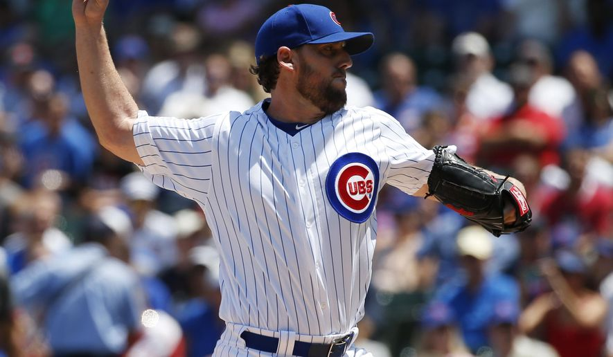 Chicago Cubs starter John Lackey throws against the Arizona Diamondbacks during the first inning of a baseball game Friday, June 3, 2016, in Chicago. (AP Photo/Nam Y. Huh)