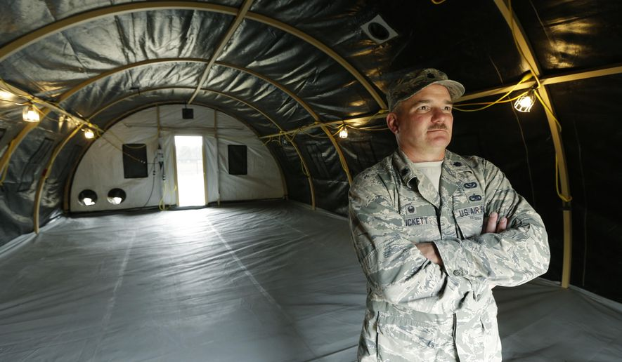 In this photo taken May 24, 2016, Washington Air National Guard Lt. Col. Curt Puckett, commander of the Guard's 141st Civil Engineer Squadron based at Fairchild Air Force Base in Spokane, Wash., stands in a temporary living structure his soldiers helped assemble at Joint Base Lewis-McChord in Washington state that will be used by troops taking part in a massive earthquake and tsunami readiness drill overseen by the Federal Emergency Management Agency on June 7-10, 2016. (AP Photo/Ted S. Warren)