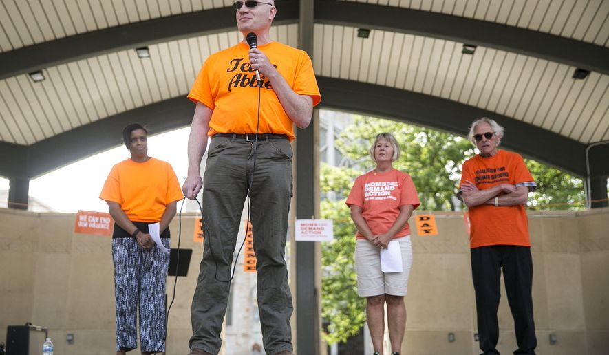 Gene Kopf, Kalamazoo mass shooting survivor Abigail Kopf's father, speaks during an event for National Gun Violence Awareness Day in Kalamazoo, Mich. on Thursday, June 2, 2016. Attendees marched around downtown Kalamazoo to raise awareness.  (Chelsea Purgahn/Kalamazoo Gazette-MLive Media Group via AP) LOCAL TELEVISION OUT; LOCAL RADIO OUT; MANDATORY CREDIT