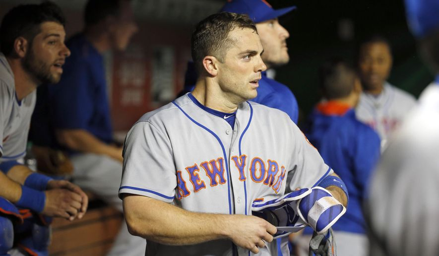 FILE - In this May 23, 2016, file photo, New York Mets' David Wright pauses in the dugout after hitting a three-run homer during the third inning of a baseball game against the Washington Nationals at Nationals Park in Washington. Wright has been placed on the disabled list because of a herniated disk in his neck, the team announced, Friday, June 3, 2016. It is retroactive to May 30. Wright has missed five straight games with the injury. (AP Photo/Alex Brandon, File)