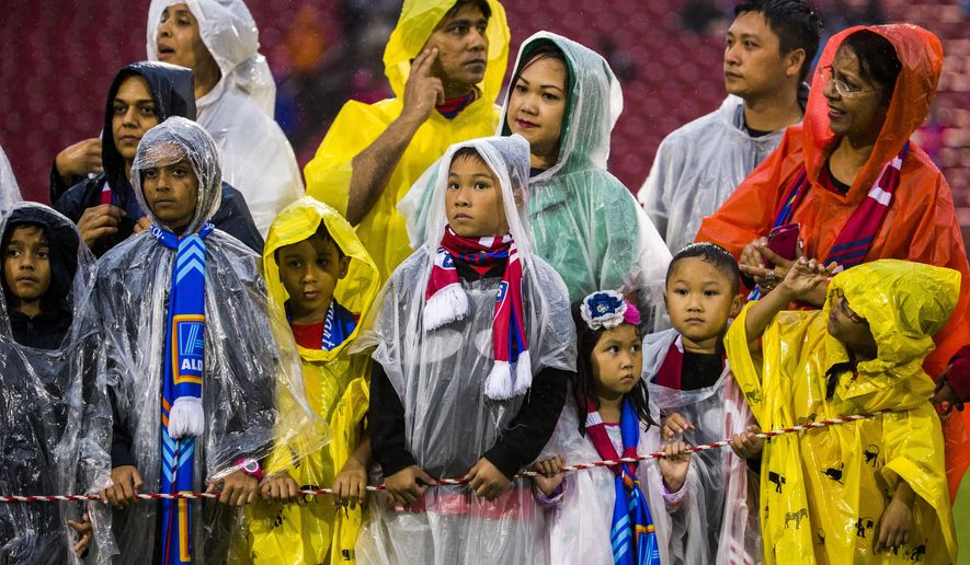 Children and their parents in rain panchos wait for team introductions before a MLS soccer game between FC Dallas and Houston Dynamo, Thursday, June 2, 2016, in Frisco, Texas.  (Ashley Landis/The Dallas Morning News via AP) MANDATORY CREDIT; MAGS OUT; TV OUT; INTERNET USE BY AP MEMBERS ONLY; NO SALES