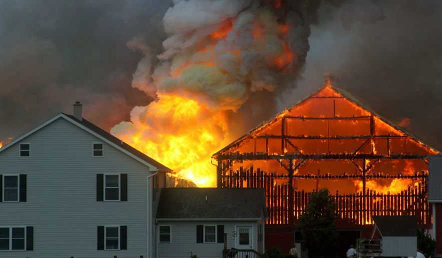 This photo provided by Travis Fisher shows shows a barn fire at a dairy farm in Clay Township, Pa., North of Ephrata on Friday, June 3, 2016.  The fire was declared under control later in the morning but crews were still remain on the scene. (Travis Fisher via AP)
