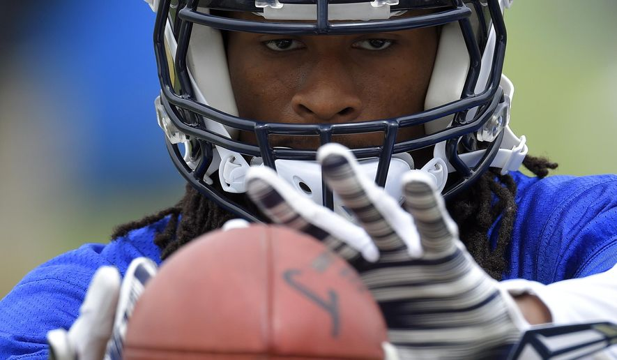 FILE - In this June 1, 2016, file photo, Los Angeles Rams running back Todd Gurley catches passes from a machine during NFL football practice in Oxnard, Calif.  In the first few months since the Rams went Hollywood, Todd Gurley has already landed commercials, endorsements and national exposure. The running back could be the breakthrough star of their move to Los Angeles, but he knows the Rams need to win, too. (AP Photo/Mark J. Terrill, File)