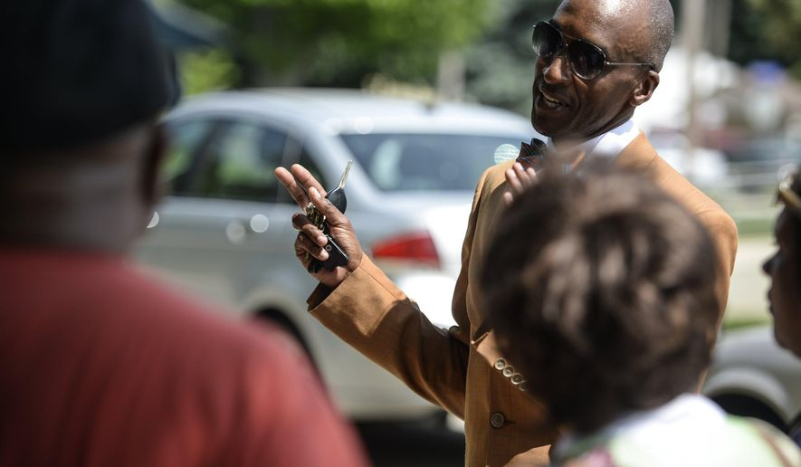 Ypsilanti Community Schools superintendent Ben Edmondson speaks to parents outside of Washtenaw International High School, Wednesday, June 1, 2016, Ypsilanti, Mich.  Police and school officials said a Washtenaw International Middle Academy student died Wednesday afternoon at the Ypsilanti school. They didn't identify him or release details of what happened.  (Junfu Han/The Ann Arbor News via AP) LOCAL TELEVISION OUT; LOCAL INTERNET OUT; MANDATORY CREDIT
