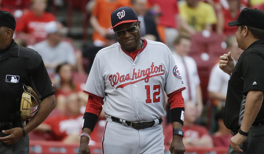 Washington Nationals manager Dusty Baker waits to shake hands with Cincinnati Reds manager Bryan Price before a baseball game, Friday, June 3, 2016, in Cincinnati. The Reds won 7-2. (AP Photo/John Minchillo)
