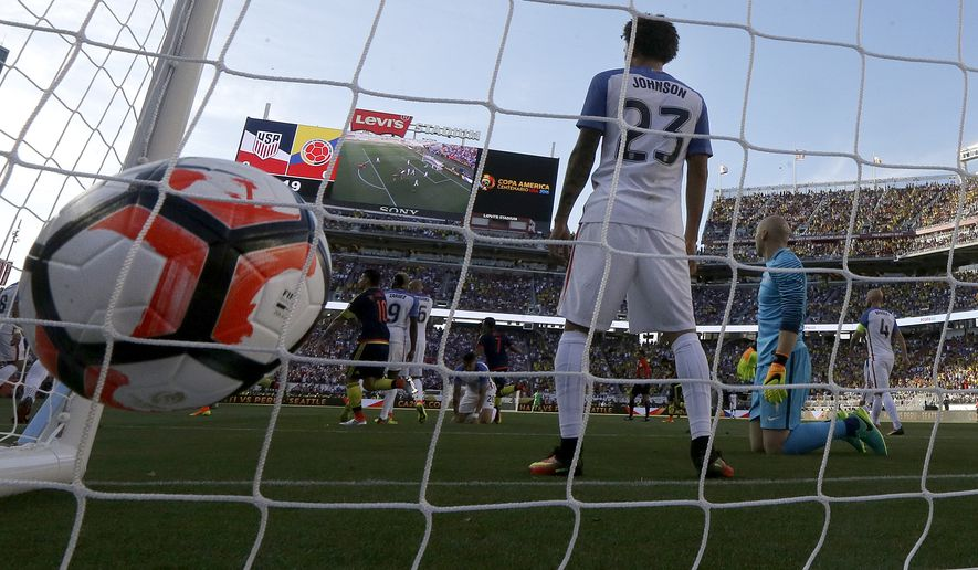 United States defender Fabian Johnson (23) and goalkeeper Brad Guzan, second from right, react after Colombia defender Cristian Zapata scored a goal in the first half during a Copa America Centenario Group A soccer match at Levi's Stadium in Santa Clara, Calif., Friday, June 3, 2016. Colombia won 2-0. (AP Photo/Jeff Chiu)