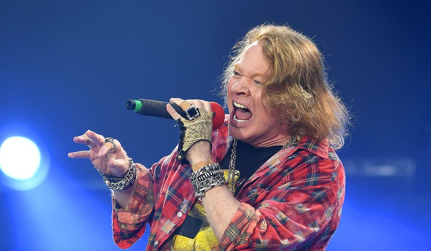 Axl Rose of the band AC/DC performs at the Olympic Stadium in London, Saturday, June 4, 2016. (Photo by Mark Allan/Invision/AP) **FILE**