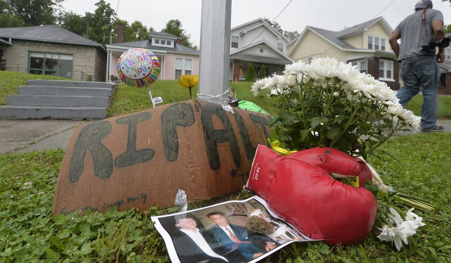 A small memorial sits in front of the boyhood home of Muhammad Ali, Saturday, June 4, 2016 in Louisville Ky.  Ali, the magnificent heavyweight champion whose fast fists and irrepressible personality transcended sports and captivated the world, has died according to a statement released by his family Friday, June 3, 2016. He was 74. (AP Photo/Timothy D. Easley)