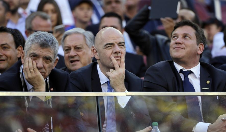 FIFA President Gianni Infantino, center, watches the opening ceremony of the Copa America Centenario at Levi's Stadium in Santa Clara, Calif., Friday, June 3, 2016. (AP Photo/Jeff Chiu)
