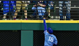 Kansas City Royals' Paulo Orlando jumps but is unable to get to a home run by Cleveland Indians' Tyler Naquin in the sixth inning of a baseball game Saturday, June 4, 2016, in Cleveland, Ohio. (AP Photo/David Dermer)