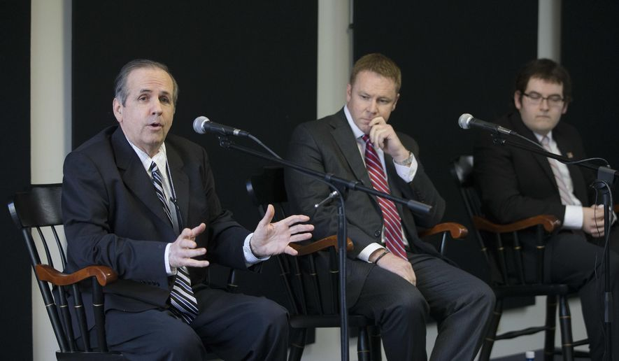 FILE - In this May 23, 2016 file photo, Green Party candidate Jim Condit Jr., left, speaks alongside Republican candidate Warren Davidson, center, and Democratic candidate Corey Foister, right, during a forum for candidates running in the 8th District special election at the Miami University Hamilton Downtown Center in Hamilton, Ohio.  The stakes are high even if attention and interest are low in a special election Tuesday, June 7 to elect the successor to former House Speaker John Boehner.   (AP Photo/John Minchillo)