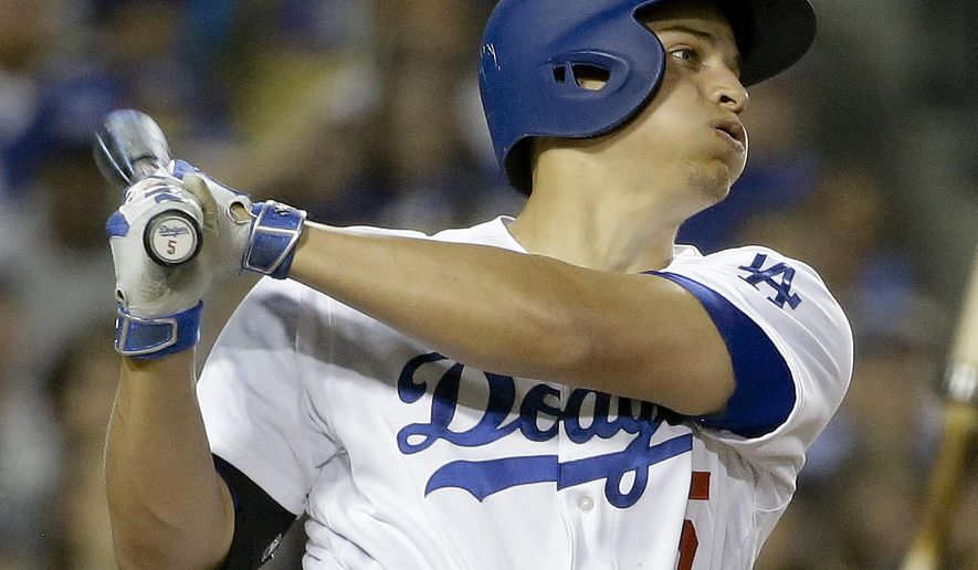 Los Angeles Dodgers' Corey Seager watches his home run against the Atlanta Braves during the sixth inning of a baseball game in Los Angeles, Friday, June 3, 2016. (AP Photo/Chris Carlson)