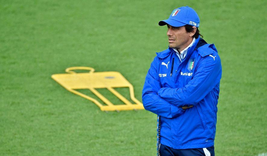 Coach Antonio Conte leads a training session of the Italian national soccer team at the Coverciano training center, near Florence, Italy, Thursday, June 2, 2016. Italy is in one of the toughest groups at Euro 2016. It opens against Belgium on June 13, before playing Sweden four days later and Ireland on June 22. (Maurizio Degl'Innocenti/ANSA via AP)