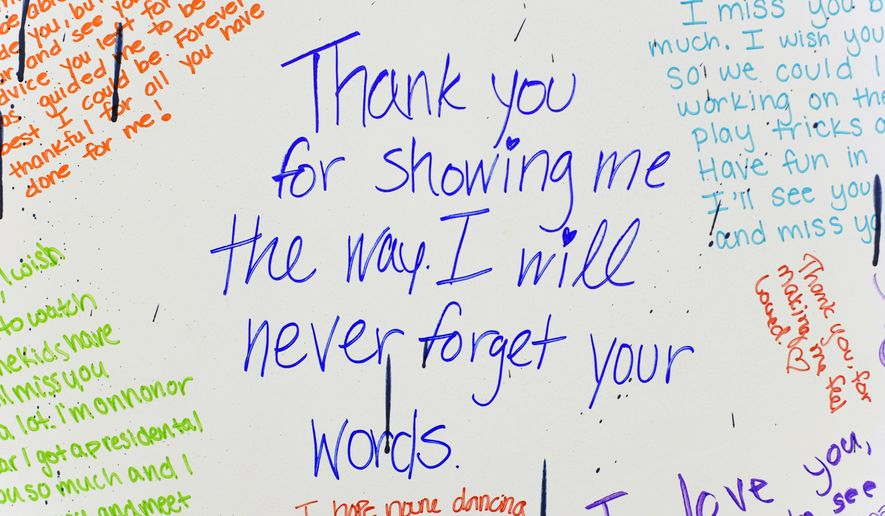 This May 11, 2016 photo shows, messages written by students to loved ones displayed at Lincoln Southwest High School, in Lincoln, Neb. The board was provided by the Mourning Hope Grief Center. (Matt Ryerson /The Journal-Star via AP) LOCAL TELEVISION OUT; KOLN-TV OUT; KGIN-TV OUT; KLKN-TV OUT; MANDATORY CREDIT