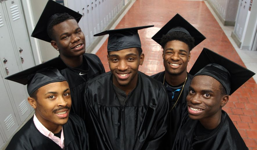 ADVANCE FOR WEEKEND EDITIONS JUNE 4-5 - In this Wednesday, May 25, 2016 photo, Samonti Tooson, Shuntavion Porter, Davion Givens, Marquas Gafeney and DeQuann Washington are five of the original Cunningham class of 17 boys from the Harbaugh-Williams Education Promise Fund that will be graduating in Waterloo, Iowa. (Matthew Putney/The Courier via AP) MANDATORY CREDIT
