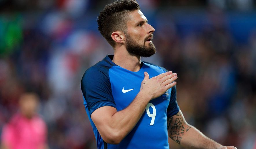 France's Olivier Giroud celebrates after scoring during the friendly soccer match between France and Scotland at the Saint Symphorien Stadium in Metz, eastern France, Saturday, June 4, 2016. The French squad is in preparation for the EURO 2016 soccer championships which will start on June 10, 2016. (AP Photo/Thibault Camus)