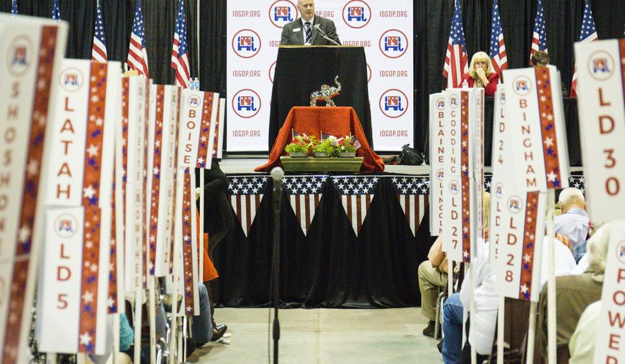 Idaho GOP Chairman Steve Yates speaks to delegates during the afternoon session of the third day of Idaho GOP Party Convention in Nampa, Idaho, Saturday, June 4, 2016. (AP Photo/Otto Kitsinger)