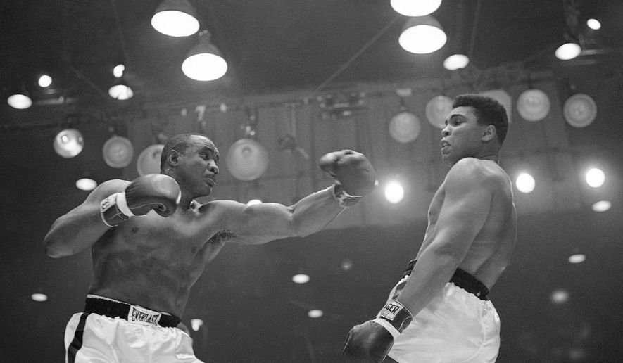 FILE - In this Feb. 26, 1964 file photo, Muhammad Ali (Cassius Clay)  uses a variety of bobbing and weaving to stay clear of the left arm of Sonny Liston in their title fight in Miami Beach, Fla.  Ali, the magnificent heavyweight champion whose fast fists and irrepressible personality transcended sports and captivated the world, has died according to a statement released by his family Friday, June 3, 2016. He was 74. (AP Photo)