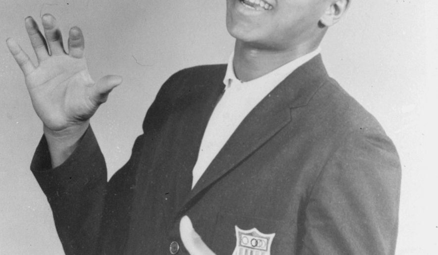 FILE - In this 1960 file photo, Muhammad Ali, then known as Cassius Clay, is shown posed in his Olympic jacket in Louisville, Ky.   Ali, the magnificent heavyweight champion whose fast fists and irrepressible personality transcended sports and captivated the world, has died according to a statement released by his family Friday, June 3, 2016. He was 74. (The Courier-Journal via AP) NO SALES; MAGS OUT; NO ARCHIVE; MANDATORY CREDIT