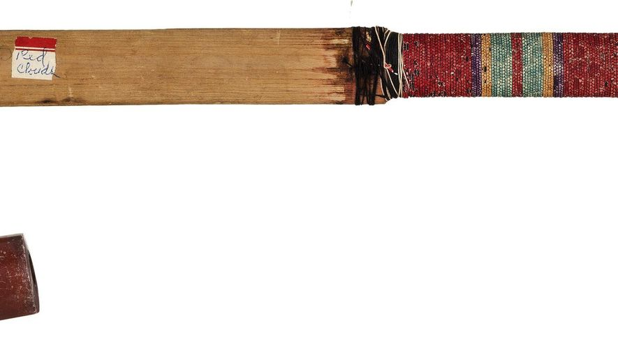 This April 2016 photo provided by Heritage Auctions, HA.com, shows a ceremonial pipe of Chief Red Cloud. It is one of more than 100 items collected from the Pine Ridge and Rosebud Indian Reservations in South Dakota that will be auctioned on June 11, 2016. (Mark Roppolo/Heritage Auctions, HA.com via AP)