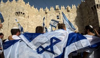 Thousands of Israelis marched through Jerusalem's Old City Sunday, including through Muslim areas, to commemorate the capture of the city's eastern sector in the 1967 Six-Day War. (Associated Press)