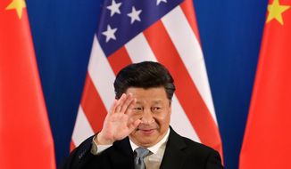 China's President Xi Jinping waves after delivering an opening speech for the 8th U.S.-China Strategic and Economic Dialogues and the 7th U.S.-China High-Level Consultation on People-to-People Exchange at Diaoyutai State Guest House in Beijing, Monday, June 6, 2016. (AP Photo/Andy Wong)