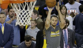 Golden State Warriors guard Stephen Curry warm up before Game 2 of basketball's NBA Finals between the Warriors and the Cleveland Cavaliers in Oakland, Calif., Sunday, June 5, 2016. (AP Photo/Marcio Jose Sanchez)