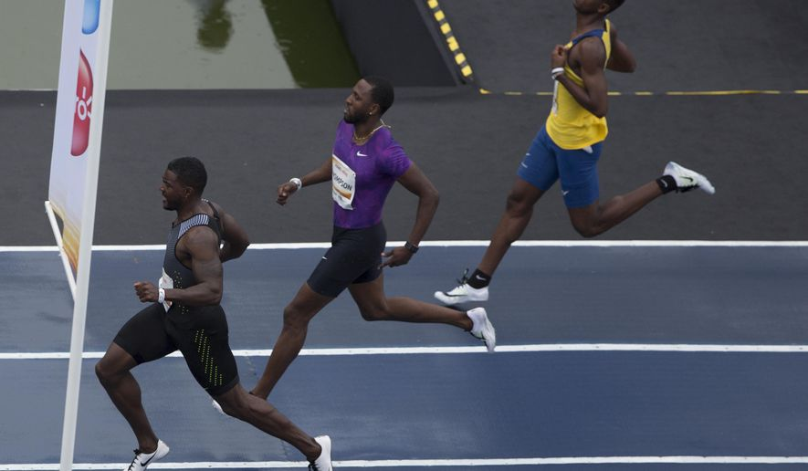 "U.S. athlete Justin Gatlin, left, finishes ahead of Trinidad and Tobago's Richard Thompson, center, and the Brazil's Vitor Hugo Santos, during the ""Mano a Mano"" challenge at the Quinta da Boavista in Rio de Janeiro, Brazil, Sunday, June 5, 2016. Gatlin won an exhibition 100-meter race as he looks forward to the Olympics in Rio. (AP Photo/Leo Correa)"