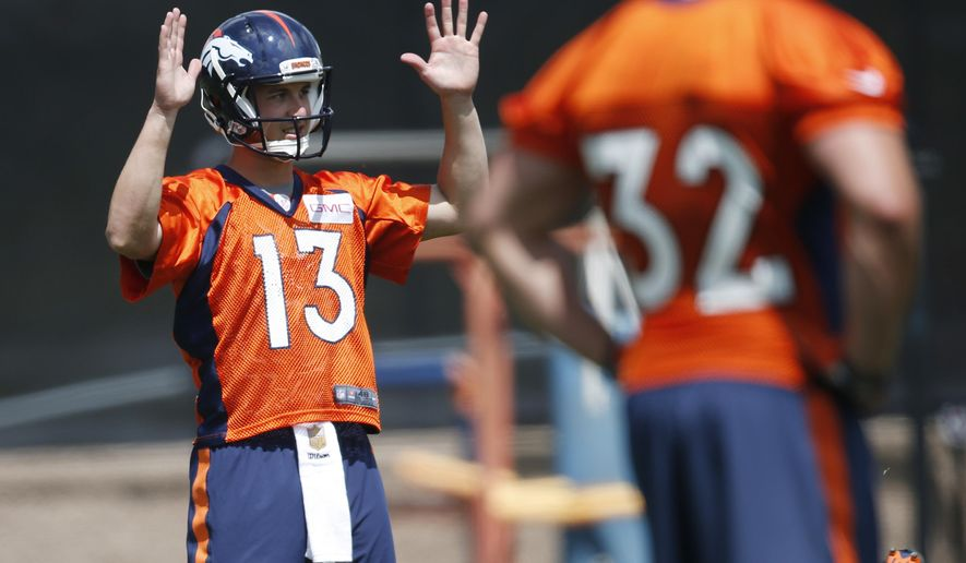 In this Tuesday, May 31, 2016, Denver Broncos quarterback Trevor Siemian calls for a ball during an NFL football practice at the team's headquarters in Englewood, Colo. Siemian is vying with Mark Sanchez and rookie Paxton Lynch for the right to lead the Super Bowl champion's offense in the season ahead. (AP Photo/David Zalubowski)