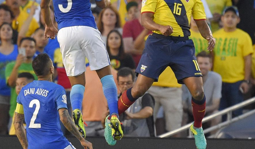 Brazil midfielder Casemiro, left, and Ecuador midfielder Antonio Valencia, right, try to head the ball as defender Dani Alves watches during a Copa America group B soccer match at the Rose Bowl, Saturday, June 4, 2016, in Pasadena, Calif. (AP Photo/Mark J. Terrill)