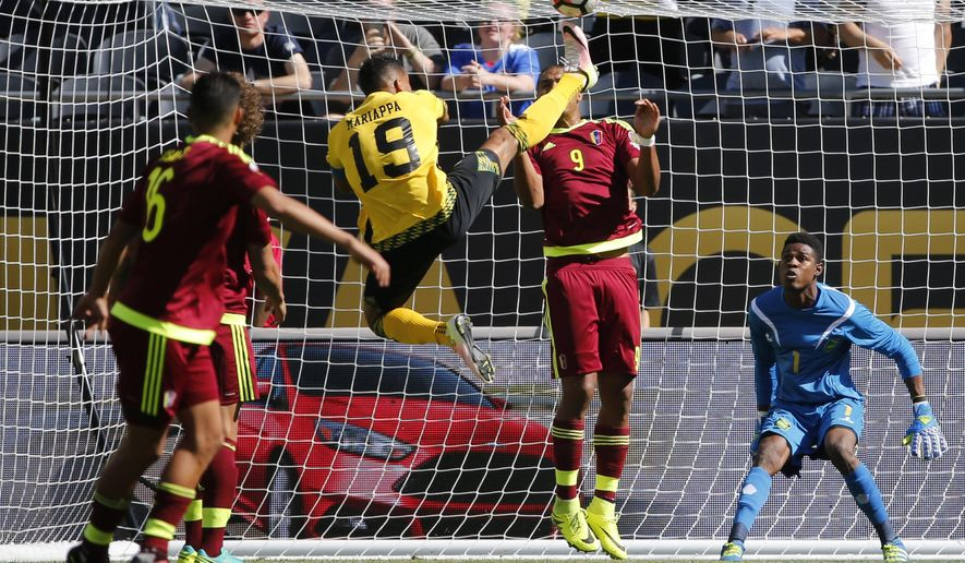 Jamaica's Adrian Mariappa (19) clears the ball over Venezuela's Jose Salomon Rondon (9) in front of the goal during a Copa America Centenario Group C soccer match at Soldier Field in Chicago, Sunday, June 5, 2016. (AP Photo/Charles Rex Arbogast)