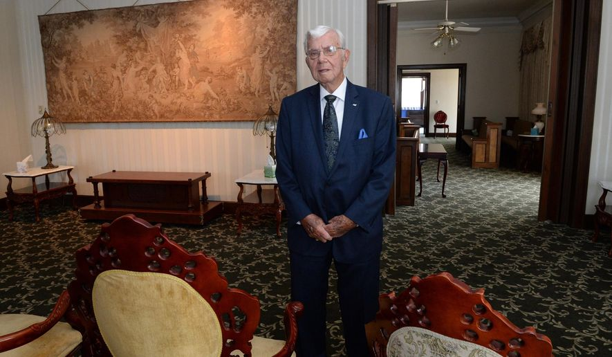 ADVANCE FOR MONDAY JUNE 6 AND THEREAFTER This Friday May 27, 2016 photo show John Cox, the funeral director at Bartlett-Burdette-Cox Funeral Home, as he stands in the facility's Victorian Room in Charleston, W.Va. A tapestry from Belgium hangs on the wall above where caskets were placed. After more than 100 years in business, the funeral home closed its doors recently. )Chris Dorst/Charleston Gazette Mail via AP)