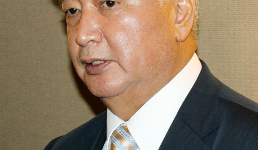 Japanese Defense Minister Gen Nakatani answers a reporter's question about the arrest of an American sailor on suspicion of drunken driving causing an accident on Japan's southern island of Okinawa, in Singapore Sunday, June 5, 2016. Petty Officer 2nd Class Aimee Mejia, 21, assigned to Kadena base in Okinawa, was arrested after driving the wrong way on a freeway and smashing head-on into two vehicles late Saturday, according to a police spokesman. (Kyodo News via AP) JAPAN OUT, MANDATORY CREDIT