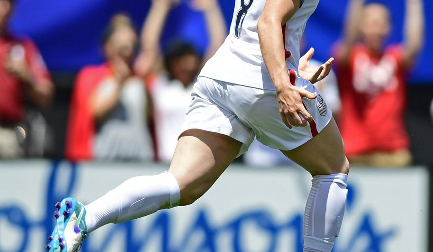 United States defender Julie Johnston celebrates after scoring a goal during the first half of an international friendly soccer match against Japan, Sunday, June 5, 2016, in Cleveland, Ohio. (AP Photo/David Dermer)