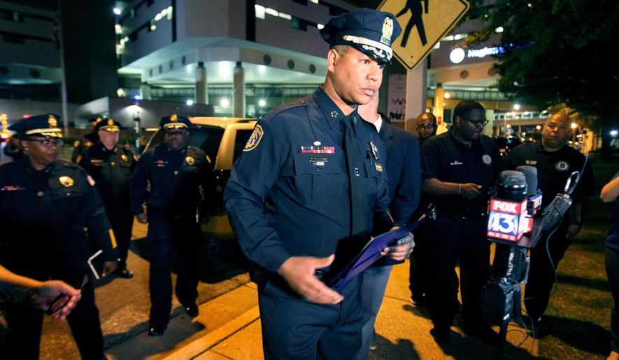 Memphis Police Department Interim Director Michael Rallings prepares to brief the media outside Regional Medical Center, early Sunday, June 5, 2016, where Officer Verdell Smith died after he was struck late Saturday by a fleeing vehicle of a man suspected in a downtown shooting, in Memphis, Tenn. (Nikki Boertman/The Commercial Appeal via AP) MANDATORY CREDIT